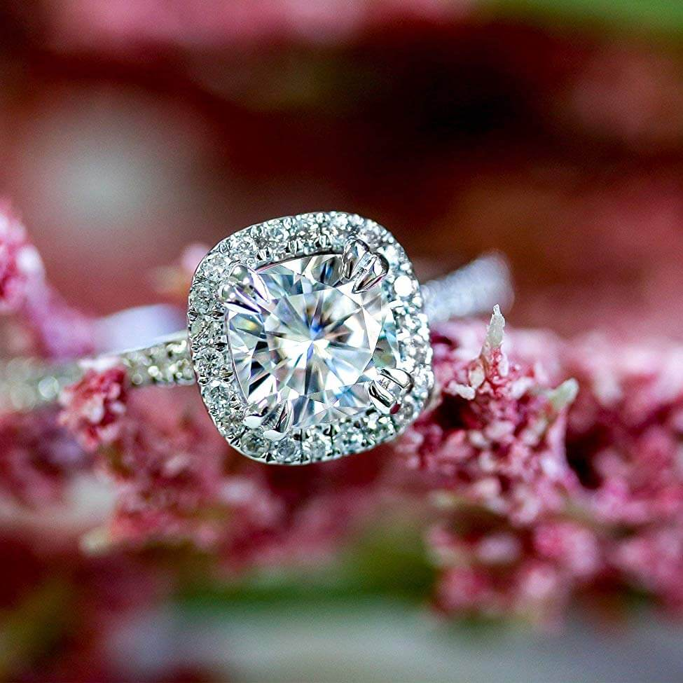 Lab Grown Diamond Halo Engagement Ring with flowers in the background