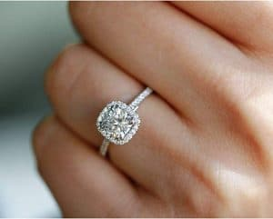 female wearing Lab Grown Diamond Halo Engagement Ring